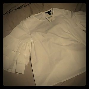 Cute white shirt with ruffels on sleeves